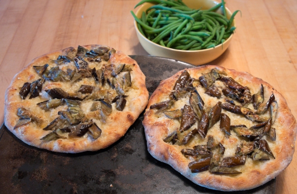 Eggplant pizza with bowl of green beans
