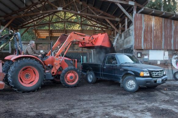 Compost David filling truck